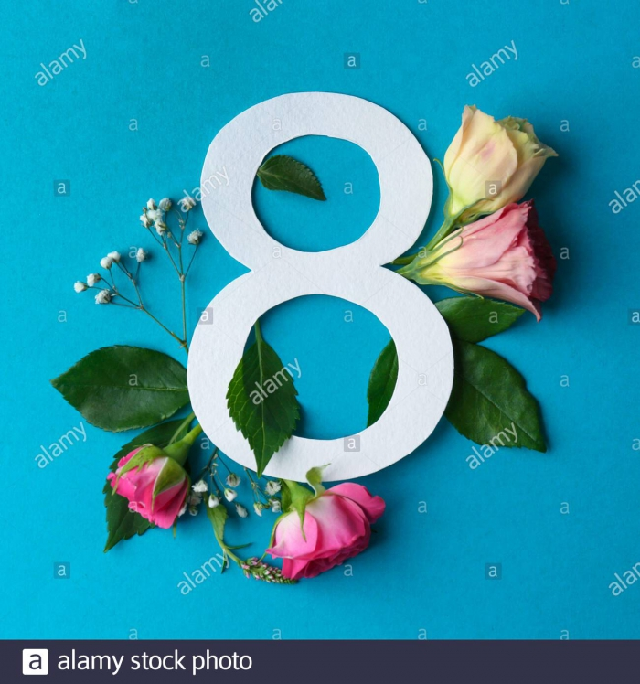 Composition With Number And Beautiful Flowers On Color